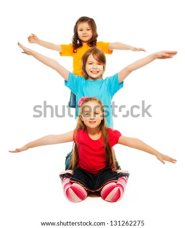 Three diversity looking kids sit on the floor waiving hands in a row one on top of another in a vertical line, smiling, happy, smiling, isolated on white