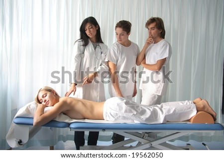 three doctor with a patient - stock photo
