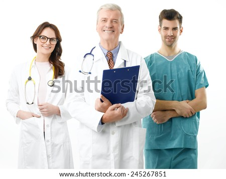 Three doctors standing against white background.