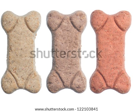 Three dog biscuit treats isolated on a white background - stock photo