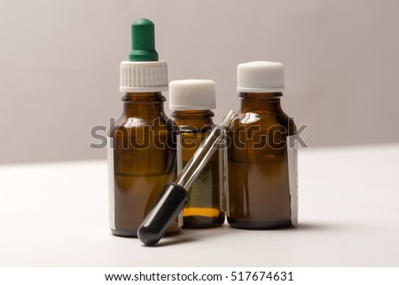 Three dropper bottles