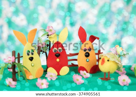Three Easter bunny and chicken.