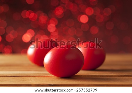 Three Easter eggs on red background - stock photo