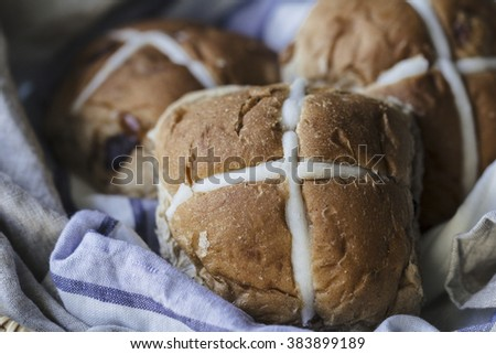 Three Easter hot cross buns in a basket - stock photo
