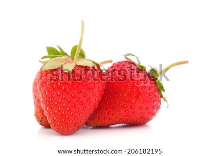 three eco strawberries on a white background - stock photo