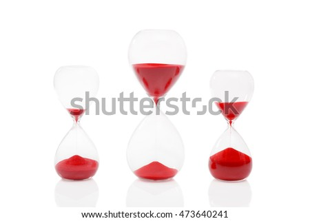 Three egg timers on a white background