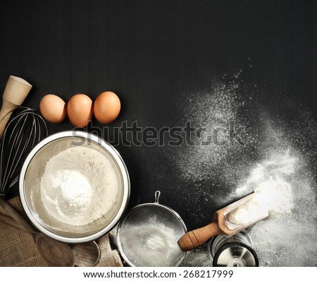 three eggs and flour  - stock photo