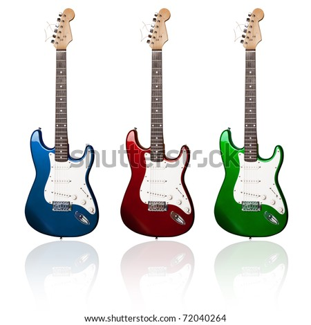 three electric guitars of different colors with reflections - stock photo