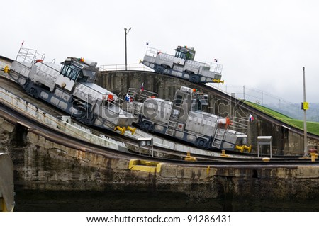 Three electric locomotives ready to help ships transit the Panama Canal - stock photo