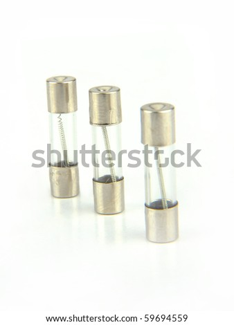 Three Electrical fuse isolated on white with clipping path - stock photo