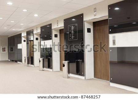 Three elevators in the lobby of an office building - stock photo