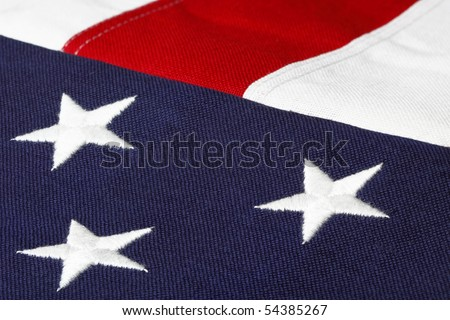 three embroidered stars of the american flag with red and white strips - stock photo