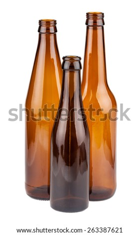 Three empty brown bottles isolated on white background - stock photo