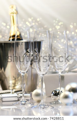 Three empty champagne glasses ready to be filled - stock photo