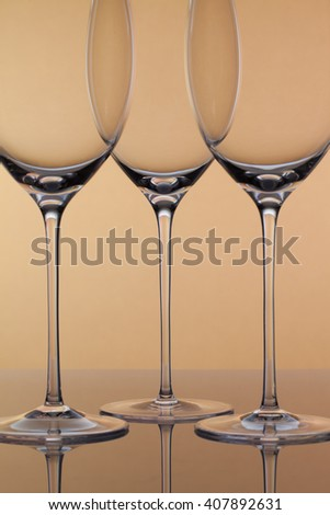 Three empty glasses of wine on a clean background