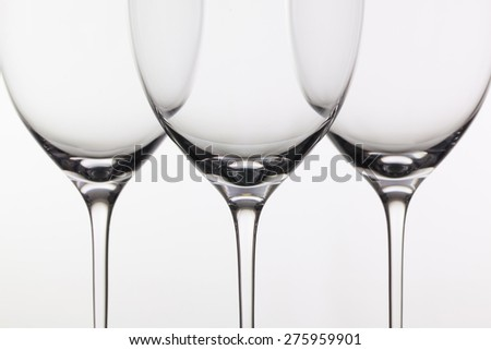 Three empty glasses of wine on the white background - stock photo