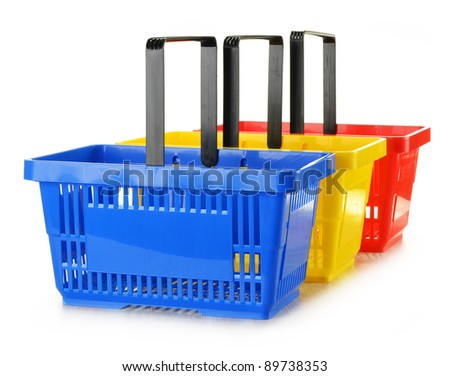 Three empty shopping baskets isolated on white - stock photo