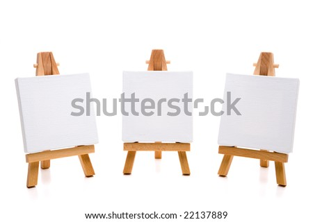 three empty white painting canvas