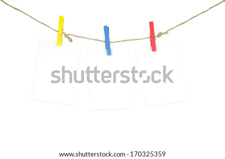 Three empty white photo frames hanging with clothespins isolated on white