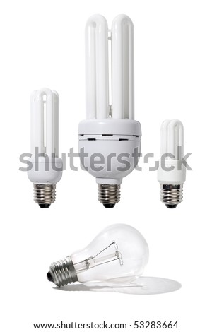 Three energy efficient light bulbs of different power and a regular light bulb isolated on white background - stock photo