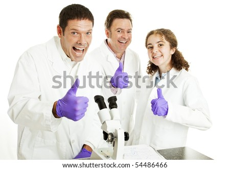 Three enthusiastic scientists (or doctors) giving a big thumbsup, happy they have had a breakthrough.  Isolated.