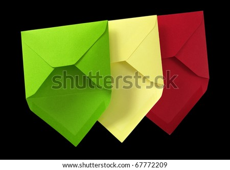 Three envelope isolated on the black surface with paths. - stock photo