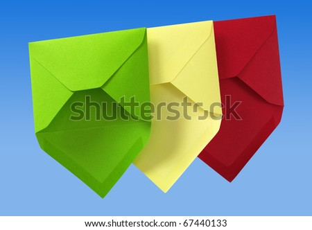 Three envelope isolated on the blue surface with paths. - stock photo