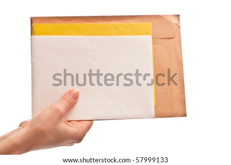 Three envelopes in woman's hands. Isolated on white - stock photo