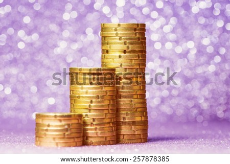 Three euro coin stacks over abstract background - stock photo