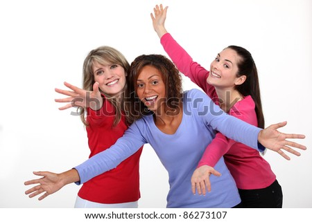 Three excited women - stock photo