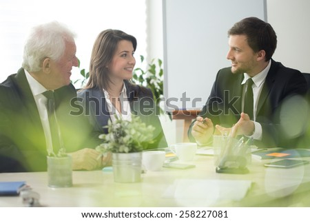 Three experienced employers and business discussion - stock photo