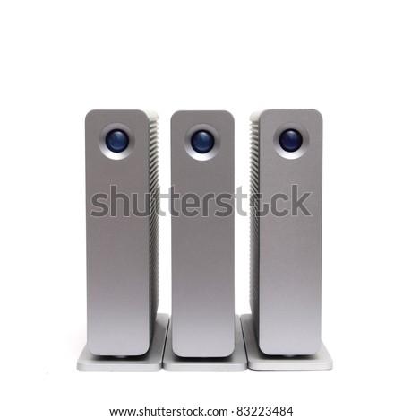 three external hard disks on a white background - stock photo
