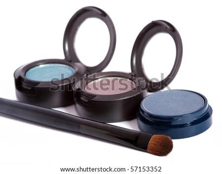 Three eyeshadows and brush - stock photo