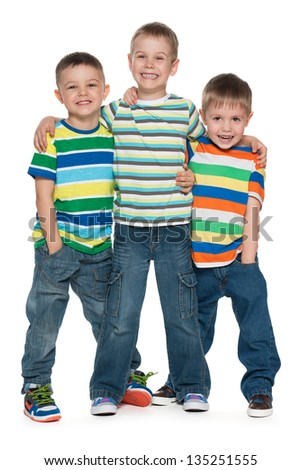 Three fashion cute boys are standing together; on the white background
