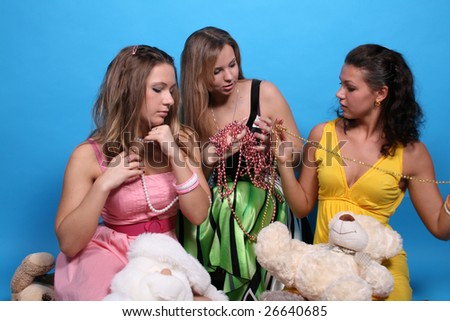 Three female friends among beads and teddy bears