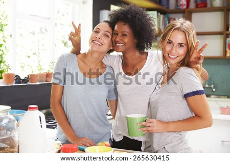 Three Female Friends Enjoying Breakfast At Home Together - stock photo