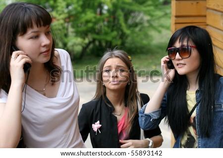 Three female friends rushing - stock photo