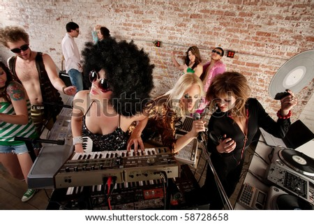 Three female performers at a 1970s Disco Music Party - stock photo
