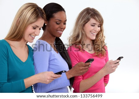 Three female students texting. - stock photo