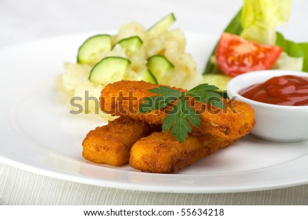 three fish fingers and potato salad
