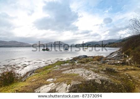 Three fishing boats on a Scottish Loch - stock photo