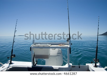 Three fishing lines off the back of a boat in the Whitsundays, Queensland, Australia