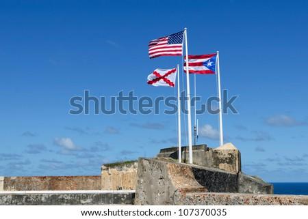 Three flags of El Morro, Puerto Rico - stock photo