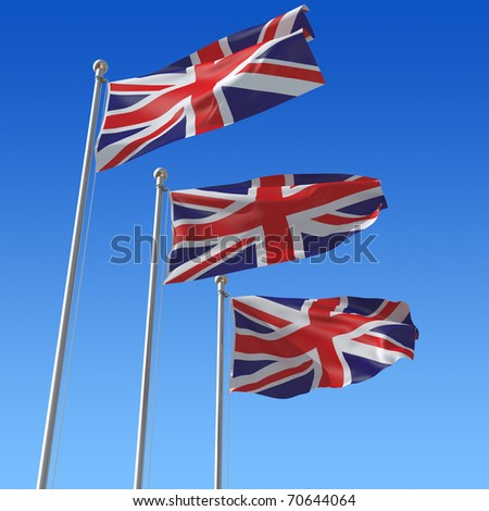 Three flags of UK against blue sky. - stock photo