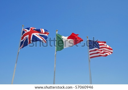 Three flags on blue sky.