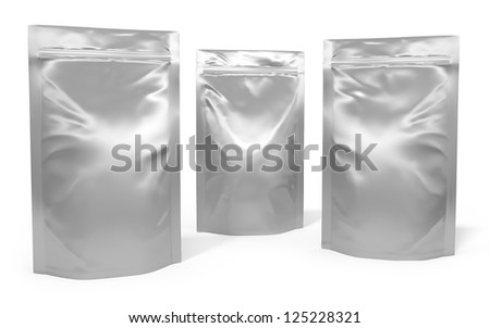 Three foil bag packages isolated on white background - stock photo