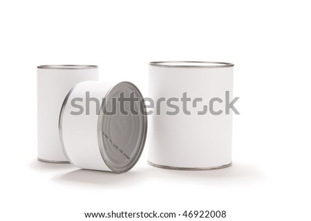 Three food cans with blank white labels. - stock photo