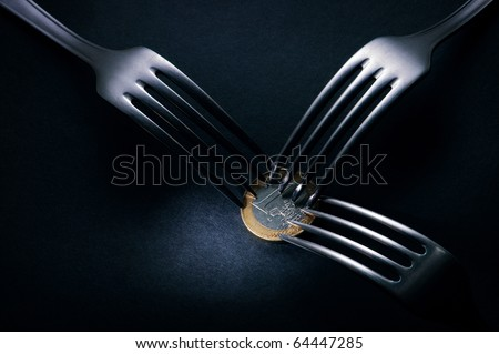 Three forks fighting over one euro coin , financial crisis competition ,dark background - stock photo
