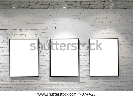 three frames on brick wall - stock photo