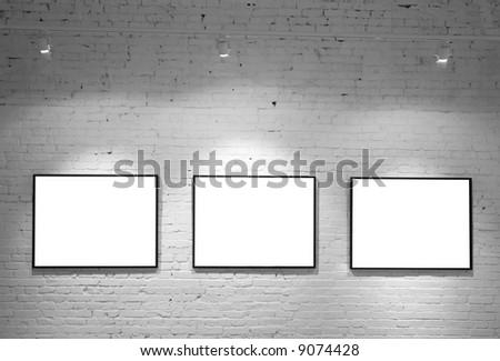 three frames on brick white wall - stock photo